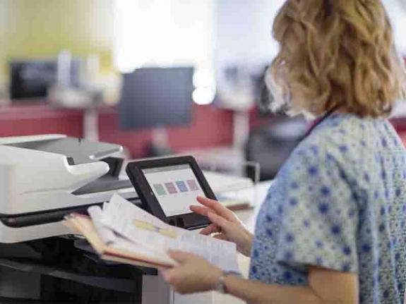 NHS worker using HP MFP